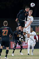 COLLEGE PARK, MD - NOVEMBER 21: Malcolm Johnson #11 of Maryland heads away from Robin Klaas #24 of Iona during a game between Iona College and University of Maryland at Ludwig Field on November 21, 2019 in College Park, Maryland.