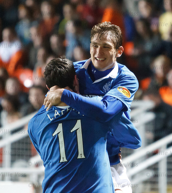 Nikica Jelavic celebrates his goal with Kyle Lafferty