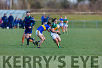 Danielle O'Leary of Kerry breaks the tackle from  Avril Geoghan of Tipperary as referee AJ Cronin keeps an eye on play, in R1 of the MLGFA Minor A Football Championship in John Mitchels GAA Complex on Sunday
