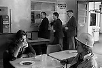 South Kirkby Colliery Yorkshire England. 1979. Miners Canteen, drinking a cup of tea. three miners queue up at the Concessionary Fuel Office.