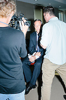 Journalists interview Democratic presidential candidate and former governor of Maryland Martin O'Malley after he spoke at a small town hall event at McLane law firm in Manchester, New Hampshire. The firm holds a town hall series, inviting candidates to speak at their headquarters.