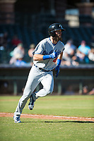Glendale Desert Dogs right fielder Cody Thomas (40), of the Los Angeles Dodgers organization, runs to first base for a single during an Arizona Fall League game against the Surprise Saguaros at Surprise Stadium on November 13, 2018 in Surprise, Arizona. Surprise defeated Glendale 9-2. (Zachary Lucy/Four Seam Images)