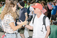 A man wearing a red MAGA hat is interviewed by a Vice reporter before the Straight Pride Parade in Boston, Massachusetts, on Sat., August 31, 2019. The parade was organized in reaction to LGBTQ Pride month activities by an organization called Super Happy Fun America.