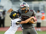 Torrance, CA 09/19/15 - Jeremiah Aiono (Torrance #28) and Zach McGuinness (Peninsula #3) in action during the Peninsula Panthers - Torrance Tartars Varsity football game at Torrance High School