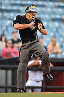 Home plate umpire Chris Gonzalez makes a call during a game between the Omaha Storm Chasers and Nashville Sounds on May 19, 2014 at Herschel Greer Stadium in Nashville, Tennessee.  Nashville defeated Omaha 5-4.  (Mike Janes/Four Seam Images)