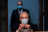 "United States Senator Chuck Grassley (Republican of Iowa) adjusts his mask before a US Senate Finance Committee hearing on ""COVID-19 and Beyond: Oversight of the FDA's Foreign Drug Manufacturing Inspection Process"" at the US Capitol in Washington, DC on June 2, 2020.<br /> Credit: Andrew Caballero-Reynolds / Pool via CNP/AdMedia"