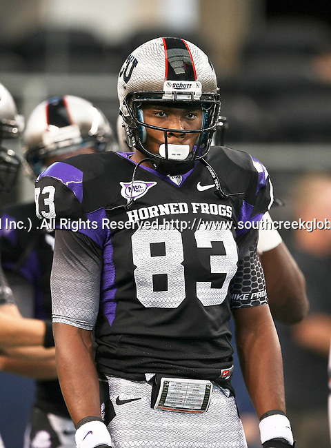 TCU Horned Frogs wide receiver Jonathan Jones #83 warming up before the game between the Oregon State Beavers and the TCU Horned Frogs at the Cowboy Stadium in Arlington,Texas. TCU defeated Oregon State 30-21.