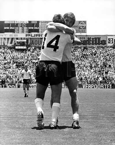 1970 World Cup Finals Mexico: GERMAN MIDFIELDER Johannes Loehr (r) hugs goalkeeper Reinhard Libuda after their win against Bulgaria by a score on 5-2 on  07.06.1970 in front of 12.700 fans.