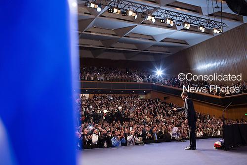United States President Barack Obama waves to the audience after delivering remarks at the Jerusalem Convention Center in Jerusalem, March 21, 2013. .Mandatory Credit: Pete Souza - White House via CNP