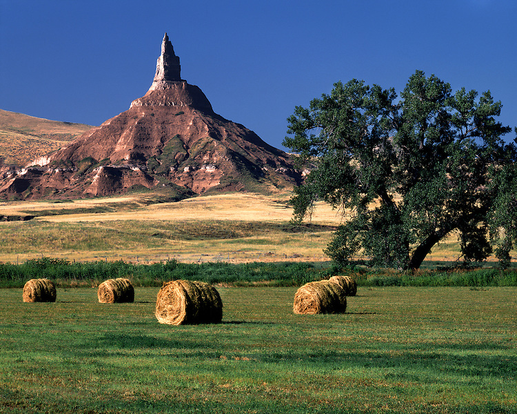 Hayrolls on a farm below Chimney Rock; Chimney Rock National Historic Site, NE