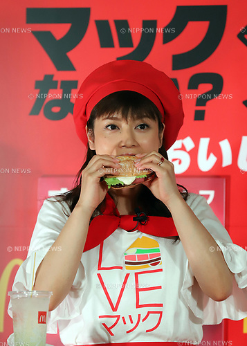 "August 7, 2017, Tokyo, Japan - Japanese actress Airi Taira displays McDonald's new burger ""Roast Beef Burger"" in Tokyo on Monday, August 7, 2017. McDonald's Japan will start a new campaign of ""Mac (Tokyo) vs McD (Osaka)"" from August 9.  (Photo by Yoshio Tsunoda/AFLO) LwX -ytd-"