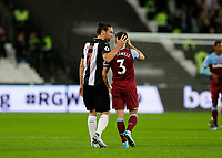 2nd November 2019; London Stadium, London, England; English Premier League Football, West Ham United versus Newcastle United; Andriy Yarmolenko of West Ham United consoles Aaron Cresswell of West Ham United after full time - Strictly Editorial Use Only. No use with unauthorized audio, video, data, fixture lists, club/league logos or 'live' services. Online in-match use limited to 120 images, no video emulation. No use in betting, games or single club/league/player publications