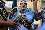 Members of Egyptian sufi muslim group play traditional instruments as they parade the street during a ritual to commemorate the Hijri New Year, also known as Islamic New Year, in Cairo on October 26, 2014. The Islamic year lasts for about 354 days and consists of 12 months. Muharram is the first month and some Muslims mark the start of the Islamic year on the first day of Muharram. Photo by Amr Sayed