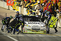 Aug 31, 2008; Fontana, CA, USA; NASCAR Sprint Cup Series driver Jimmie Johnson pits during the Pepsi 500 at Auto Club Speedway. Mandatory Credit: Mark J. Rebilas-