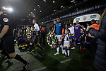 The players walking on to the pitch carrying commemorative wreaths to mark Armistice Day before West Bromwich Albion take on Leeds United in a SkyBet Championship fixture at the Hawthorns. Formed in 1878, the home team were relegated from the English Premier League the previous season and were aiming to close the gap on the visitors at the top of the table. Albion won the match 4-1 watched by a near-capacity crowd of 25,661.