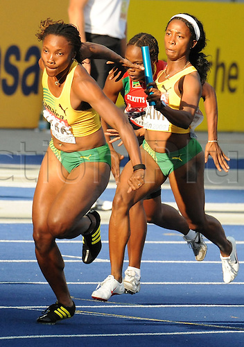 Shelly-Ann Fraser (R) of Jamaica hands over the baton to Aleen Bailey in the 4x100m relay heat at the 12th IAAF World Championships in Athletics, Berlin, Germany, 22 August 2009. Photo: BERND THISSEN/ActionPlus. UK Licenses Only.
