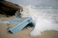 20061026 HONOLULU, HAWAI : UNITED STATES OF AMERICA  A broken blue plastic box is washed up on Kahuku beach, Honolulu, Hawaii, 26th October 2006. Greenpeace are highlighting the threat that plastic poses to the world's oceans.<br /> ALEX HOFFORD