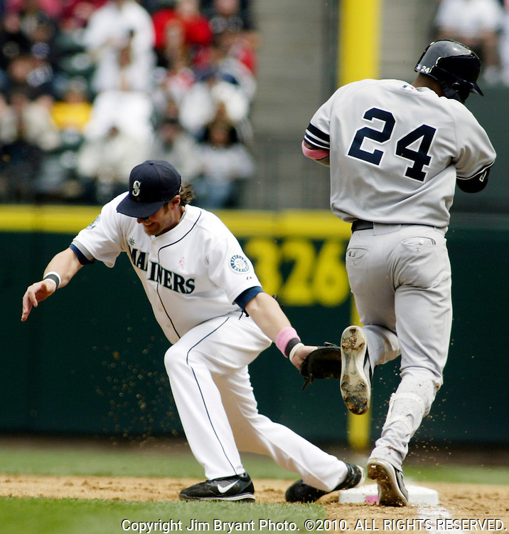 Seattle Mariners' first baseman Richie Sexson, left, catches the ball for an out as New York Yankees' Robinson Cano tries to beat throw in the third inning at Safeco Field in Seattle on May 13, 2007.      Jim Bryant Photo. ©2010. All Rights Reserved