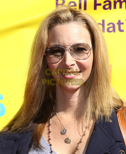 LISA KUDROW .P.S. Arts Express Yourself 2009 held At Moca, Santa Monica, California, USA, .15th November 2009..portrait headshot  ray bans sunglasses necklaces peace sign necklace silver gold aviators smiling .CAP/ADM/KB.©Kevan Brooks/AdMedia/Capital Pictures.