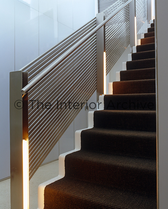 The low-maintenance painted metal staircase and banister are simple practical and durable