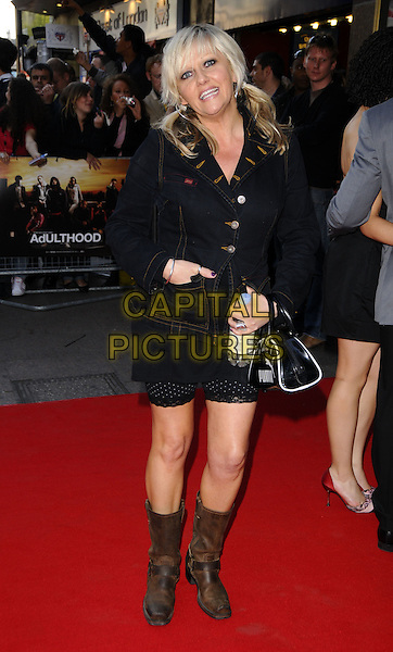 """CAMILLE CODURI.World Premiere of """"Adulthood"""" held at the Empire Leicester Square, London, England, UK, .June 17th 2008 .arrivals full length denim jacket bag black water bottle bunches brown biker boots .CAP/CAN.©Can Nguyen/Capital Pictures."""