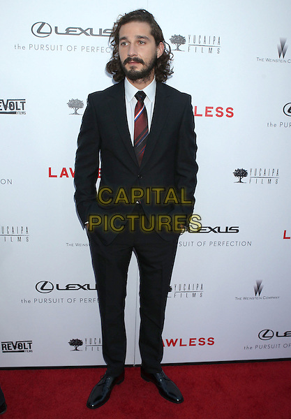 "Shia LaBeouf.""Lawless"" premiere held at ArcLight Cinemas, Hollywood, California, USA..August 22nd, 2012.full length black suit white shirt tie beard facial hair red hands in pockets .CAP/ADM/RE.©Russ Elliot/AdMedia/Capital Pictures."
