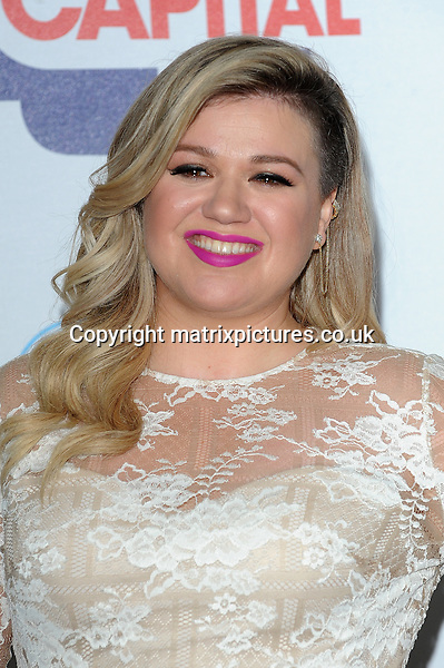 NON EXCLUSIVE PICTURE: PAUL TREADWAY / MATRIXPICTURES.CO.UK<br /> PLEASE CREDIT ALL USES<br /> <br /> WORLD RIGHTS<br /> <br /> American singer Kelly Clarkson attends The Capital FM Summertime Ball at Wembley Stadium in London.<br /> <br /> JUNE 6th 2015<br /> <br /> REF: PTY 151822