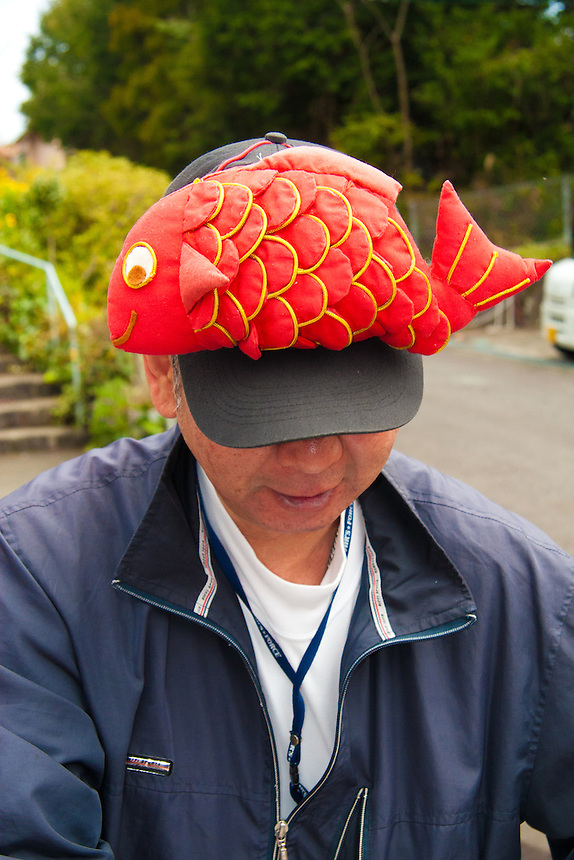 Man wearing a funny fish hat