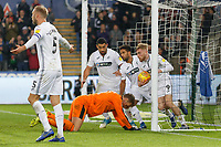 Oli McBurnie of Swansea City (R) grabs the ball from the Wigan Athletic nets after an own goal by Dan Burn during the Sky Bet Championship match between Swansea City and Wigan Athletic at the Liberty Stadium, Swansea, Wales, UK. Saturday 29 December 2018