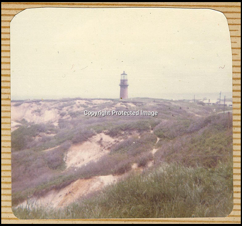 BNPS.co.uk (01202 558833)<br /> Pic: NateDSaunders/BNPS<br /> <br /> ***Please use full byline***<br /> <br /> Lighthouse in the fictional town of Amity<br /> <br /> Rare behind-the-scenes photographs taken on the set of the cult movie 'Jaws' has surfaced after 40 years.<br /> <br /> The 75 pictures include ones of star Roy Scheider, who played shark-hunting police chief Brody in the classic 1975 film, and director Steven Spielberg.<br /> <br /> There are several snaps of the giant mechanical rubber shark that wreaked terror on the fictional seaside resort of Amity.<br /> <br /> It is depicted being hoisted in the air and moved into position as well as sat in a dry dock during a break in the filming.