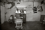 Santiago de Cuba:<br /> Street scene neighborhood barber