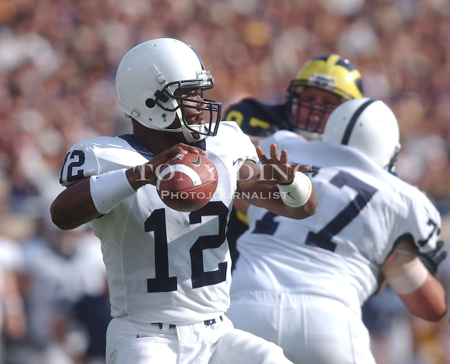 Penn State quarterback Michael Robinson (12) only didn't play very much during the Michigan-Penn State matchup at the Big House on Saturday, October 12, 2002 (Tony Ding/Daily).