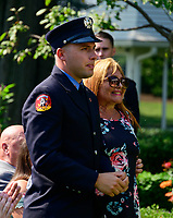 The family of East Meadow Volunteer Firefighter Ray Pfeifer stand after being introduced by United States President Donald J. Trump as he makes remarks prior to signing H.R. 1327, an act to permanently authorize the September 11th victim  compensation fund, in the Rose Garden of the White House in Washington, DC on Monday, July 29, 2019. Ray's wife Caryn, right, and his son Terence, who is now a New York City firefighter, left, are pictured.  Pfeifer died of cancer in 2017.<br /> Credit: Ron Sachs / Pool via CNP<br />  <br /> Here with us today is/AdMedia