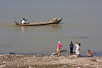 Myanmar, Burma. Bagan.  Ayeyarwady (Irrawaddy) River Scene.  Women Doing Laundry.