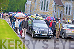 Killarney vintners form a guard of honour as the remains of the late Christy McSweeney are taken from St Marys Cathedral, Killarney on Thursday morning...