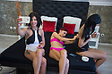 Romania - Timisoara - Krina (left), Nathali Rose (center) and Lynette Smith (right) get ready for a photoshoot organized by the Live Cams Mansion in order to promote the girls on the online platfmors where they meet their clients.