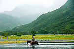 Chris and Rochelle crossing the river at the  Pasagshak Ranch on Kodiak Island,  Southwest Alaska