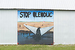 A mural painted on the side of a barn near Montmagny Quebec that shows the resident is against the proposed Energy East pipeline. (Credit: Robert van Waarden - http://alongthepipeline.com)