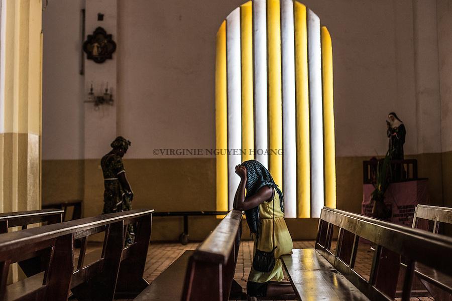 CAR, Bangui: A christian woman is praying in the cathedrale of Bangui. 22th April 2016. <br /> <br /> RCA, Bangui : Une femme chr&eacute;tienne est en train de prier dans la cath&eacute;drale de Bangui . 22 Avril 2016.