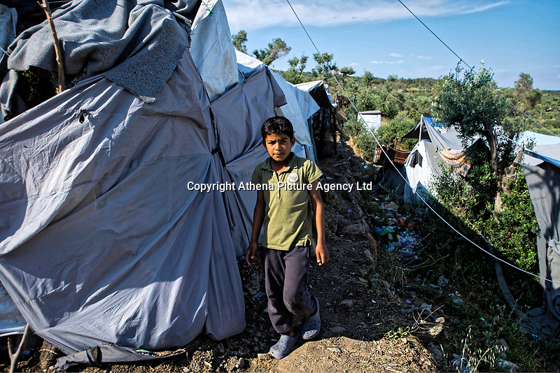 Pictured: A young boy walks by the tents.<br /> Re: Everyday life at the Moria refugee camp on the island of Lesbos, Greece.