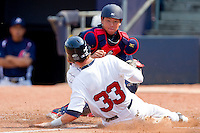 Catcher Ryutaro Umeno #22 of the Japan Collegiate National Team tags out Tyler Naquin #33 (Texas A&M) of the USA Baseball Collegiate National Team as he tries to score on a bunt at the Durham Bulls Athletic Park on July 3, 2011 in Durham, North Carolina.  USA defeated Japan 7-6.  (Brian Westerholt / Four Seam Images)