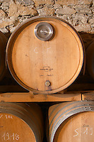 Domaine Piccinini in La Liviniere Minervois. Languedoc. Barrel cellar. Barrel with special metal fitting for red wine barrel fermentation. France. Europe.