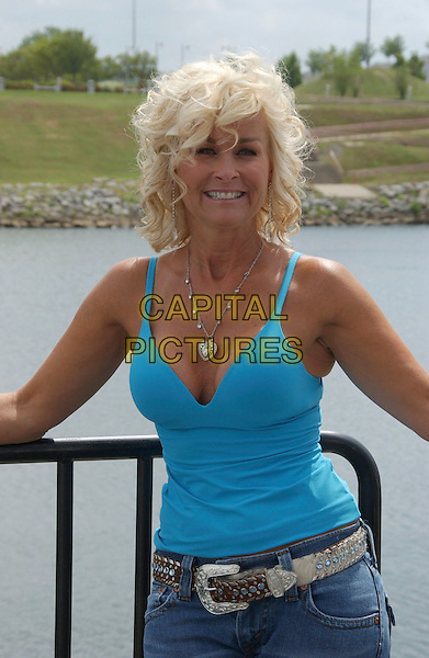 LORRIE MORGAN.2007 CMA Music Festival held at Greased Lightning Daytime Stage at Riverfront Park, Nashville, Tennessee, USA..June 8th, 2007.half length blue turquoise tank top cleavage silver heart necklace belt .CAP/ADM/LF.©Laura Farr/AdMedia/Capital Pictures