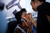 SOWETO, SOUTH AFRICA SEPTEMBER 23: An unidentified girl has her makeup up done backstage before a beauty competition on September 23, 2006 in Soweto, Johannesburg, South Africa. The competition was part of Soweto festival. Soweto is South Africa&rsquo;s largest township and it was founded about one hundred years to make housing available for black people south west of downtown Johannesburg. The estimated population is between 2-3 million. Many key events during the Apartheid struggle unfolded here, and the most known is the student uprisings in June 1976, where thousands of students took to the streets to protest after being forced to study the Afrikaans language at school. Soweto today is a mix of old housing and newly constructed townhouses. A new hungry black middle-class is growing steadily. Many residents work in Johannesburg but the last years many shopping malls have been built, and people are starting to spend their money in Soweto.  <br /> (Photo by Per-Anders Pettersson)