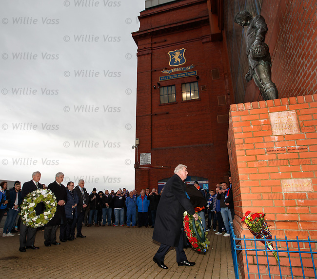 Rangers and Celtic directors lay wreaths before the match to remember the Rangers fans who perished in the Ibrox Disaster of 1971. An emotional John Greig looks up at his image on the statue as he lays a wreath as Ian Bankier of Celtic looks on