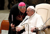 Papa Francesco ascolta Monsignor Georg Gaenswein durante l'udienza generale del mercoledi' in aula Paolo VI, Citta' del Vaticano,7 gennaio 2015.<br /> Pope Francis, listens to Monsignor Georg Gaenswein, during his weekly general audience in the Paul VI hall at the Vatican, 7 January 2015.<br /> UPDATE IMAGES PRESS/Isabella Bonotto<br /> <br /> STRICTLY ONLY FOR EDITORIAL USE