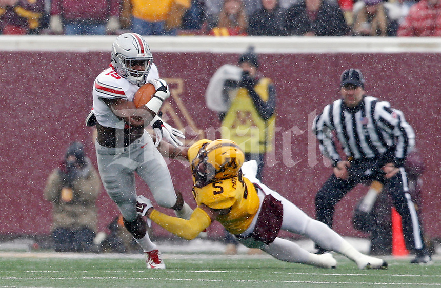 Ohio State Buckeyes running back Ezekiel Elliott (15) gets past Minnesota Golden Gophers linebacker Damien Wilson (5) during the 1st quarter at TCF Bank Stadium in Minneapolis, Minn. on November 15, 2014.  (Dispatch photo by Kyle Robertson)
