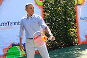 United States President Barack Obama plays tennis on the court of the South Lawn at the annual Easter Egg Roll on the South Lawn of the White House on April 21, 2014.  <br /> Credit: Dennis Brack / Pool via CNP