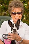 Woman with Boston terrier