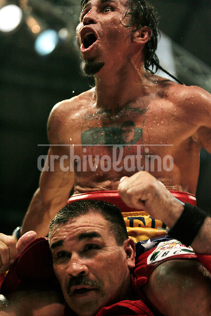 """Edwin Valero of Venezuela celebrates his victory against Mexican Héctor Velazquezfor the World-wide Council of Box (CMB), in Caracas,  December 20th 2009.Valero, famed for an impressive record of 27 straight knockouts and a huge tattoo of Chavez on his chest, hanged himself in his jail cell last week. The boxer, who was nicknamed """"El Inca"""" in reference to an Indian warrior, committed suicide a day after he was arrested for murdering his 24-year-old wife."""